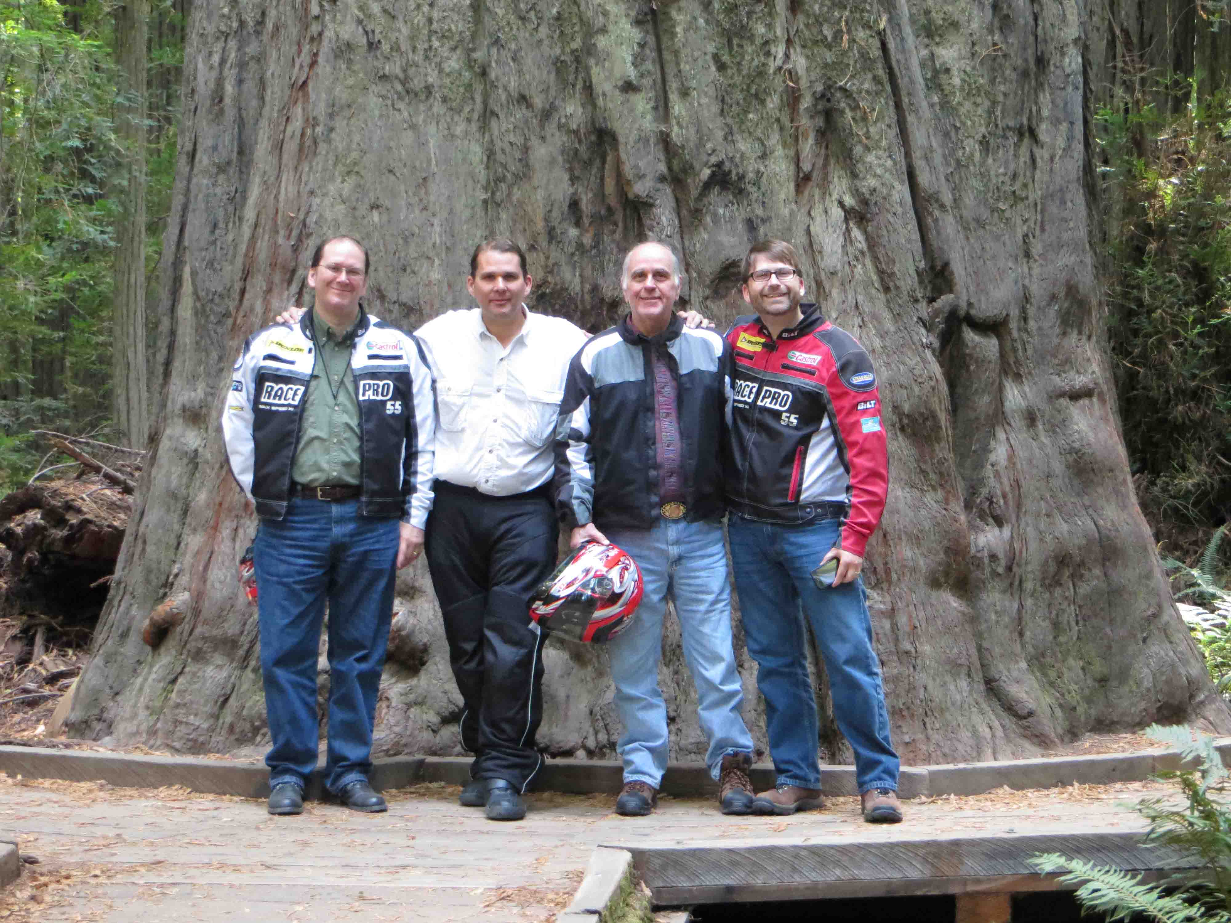 Family in front of giant redwood tree